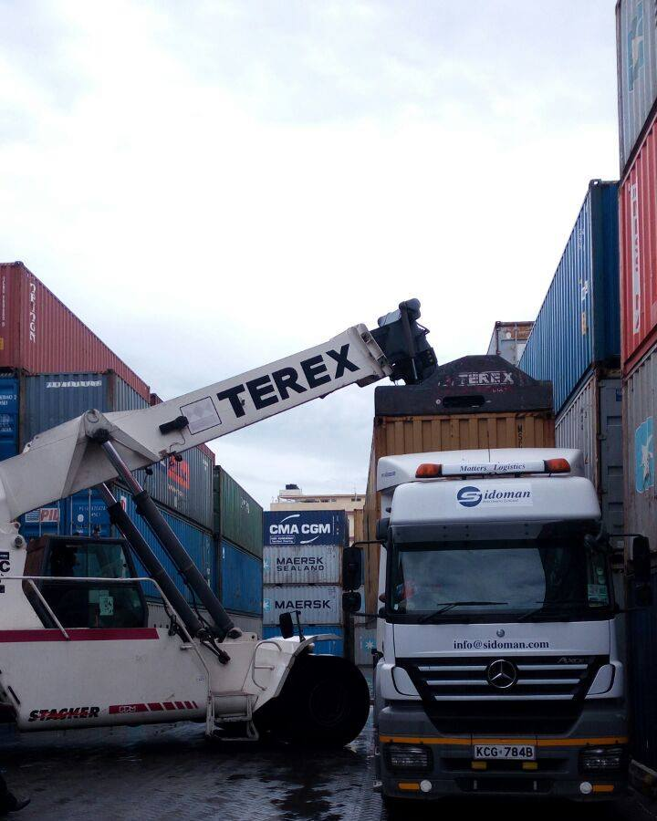 Goods being offloaded to  a Sidoman Truck at the Port of Mombasa. Some shipping Terms may be difficult to understand [Image: Sidoman]